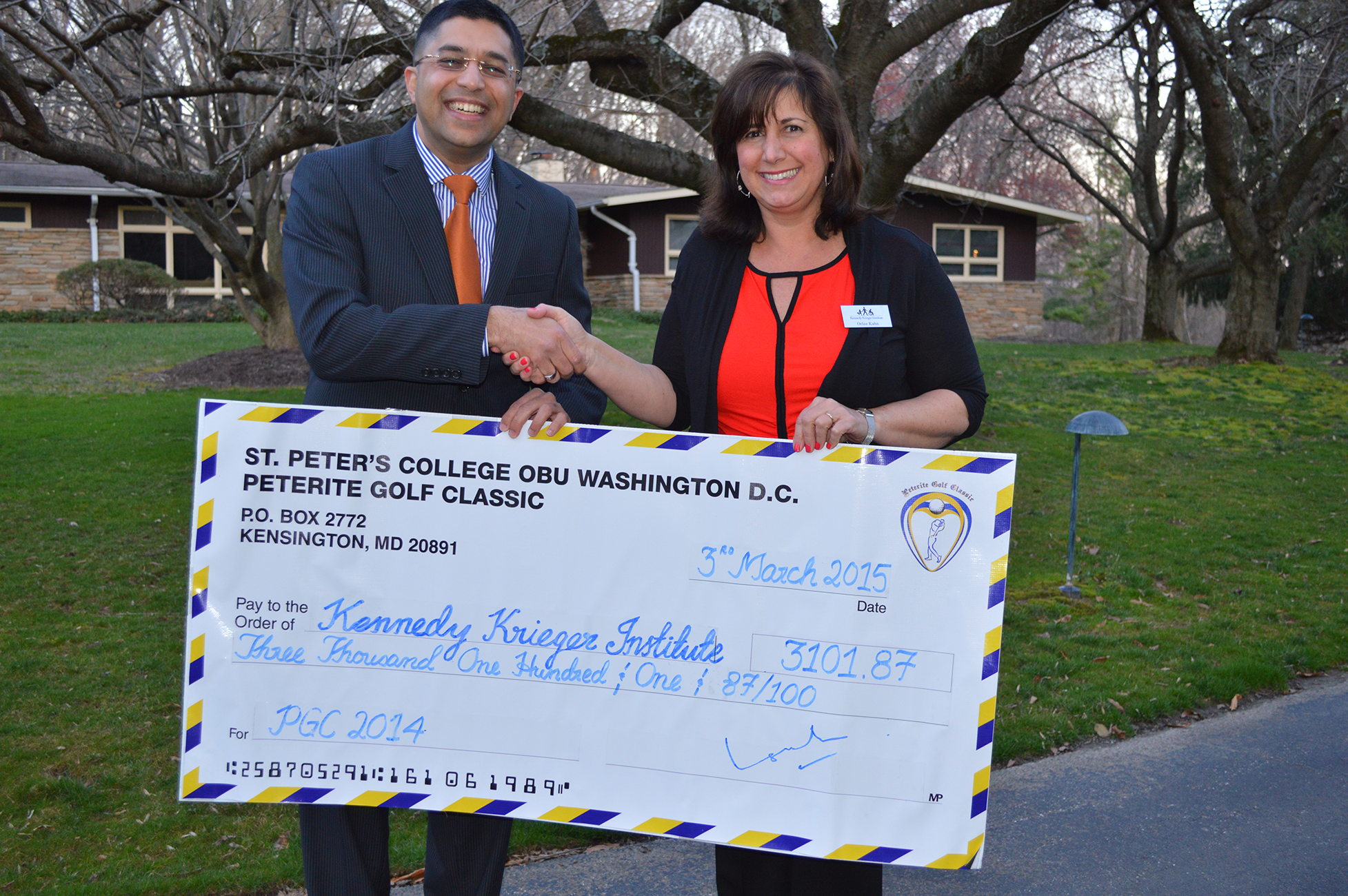 Left to right Mr. Gaddafi Ismail-Deputy Chair-PGC, handing over the cheque to Mrs. Orlee Kahn, Director of Planned Giving, International Center for Spinal Cord Injury, Kennedy Krieger Institute-Baltimore,MD,USA.