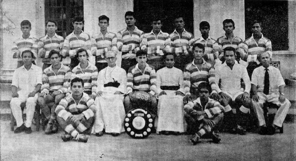 Standing Left to Right: N. Maurice, G. Alagaratnam, P.de Zylva, C. Wickramaratne, S. Silva, M. Wright, L. Corera, L. Landersz, M. Gomesz, R. Fernando. Seated Left to Right: Mr. Austin Fernando (Master in charge), R. Soyza, S. Perera (Vice Captain), Rev. Fr. Basil Weeratunga (Rector), R. Gunaratne (Captain), Rev. Fr. Rufus Benedict (Prefect of Games), D. Harridge, Mr. N. Marthalingam (Asst. Caoch), Mr. Archibald Perera (Coach) On the Ground Left to Right: R. Almeida, M.Mohideen