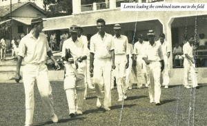 Lorenz Pereira leading the Combined College cricket team to the field at St. Peter's College Grounds, 1958